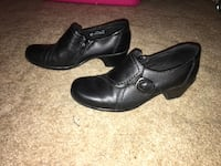 pair of black leather shoes 1156 mi