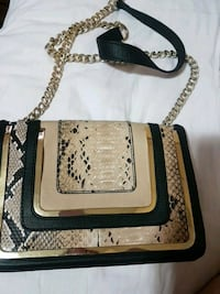 black, brown, and beige snakeskin leather crossbody bag
