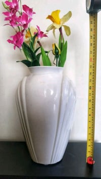 White ceramic flower vase with silk flowers