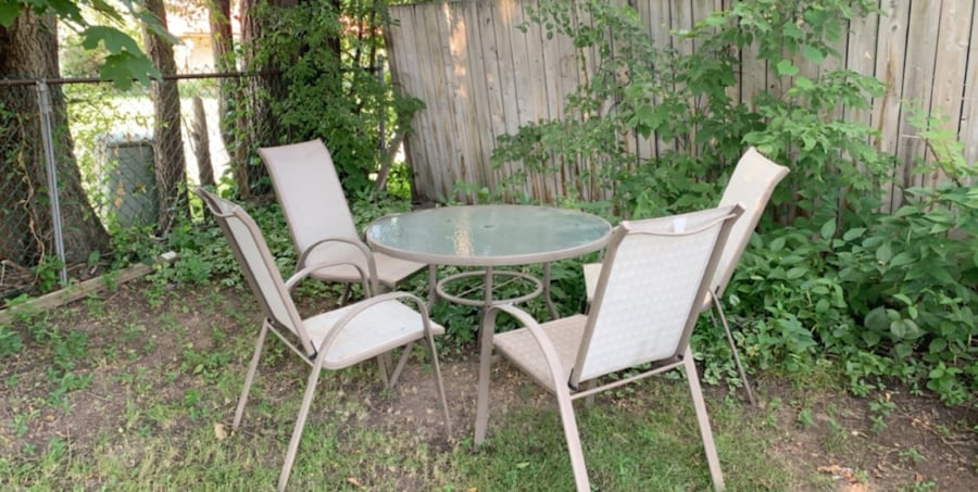 Patio set- table and 4 chairs with cushions 8da43383-c86c-4912-ac6e-4d3582a23a98