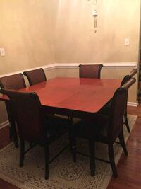rectangular brown wooden table with six chairs Glen Allen, 23059