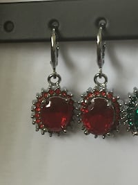pair of silver-colored and red gemstone earrings East Brunswick