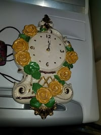 white,yellow and green floral ceramic analog wall clock