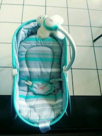 baby's teal and white bouncer Amarillo