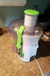 white and green power juicer 63 km