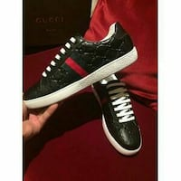 pair of black Gucci shoes