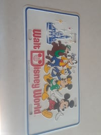 white Walt Disney World metal license plate Fort Myers, 33901
