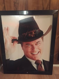 JR Ewing Picture 22 x 18. Screw holes on top and bottom of frame, slight scuffs, can be repainted. Came out of a restaurant.  Franklin, 37064