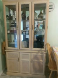 brown wooden framed glass display cabinet Duncanville, 75137