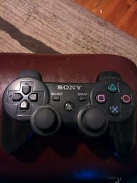black Sony PS3 game controller 917 mi