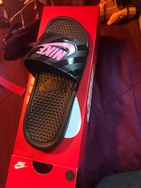 pair of black-and-red Nike slide sandals Amarillo, 79109