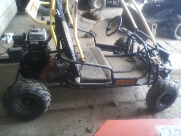 Two seater go cart runs good paid over 900.00 for it call  [TL_HIDDEN]  ask for Joel