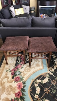brown wooden framed benches with cushion