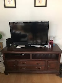 flat screen television with brown wooden TV stand Falls Church, 22302
