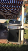 Black and gray Weber outdoor propane gas grill