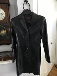 Danier Beautiful Ladies 3/4 Length Black Ladies Jacket. Size Petite. Fits like a Small. Perfect Condition. Made in Canada. Two front pockets. Cochrane, T4C 1K6