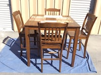 rectangular brown wooden table with four chairs dining set North Las Vegas, 89030