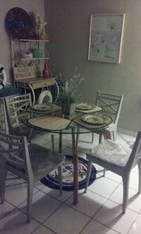 Round glass table with 4wooden chairs Fort Myers, 33908