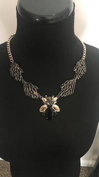 silver and gold pendant necklace