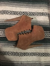 pair of brown suede lace-up platform stiletto booties