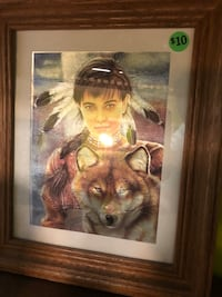 Brown wooden framed of woman and wolf East Hartford