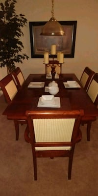 rectangular brown wooden table with six chairs din null