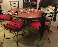 Round brown wooden table with six chairs dining set Oxnard, 93036