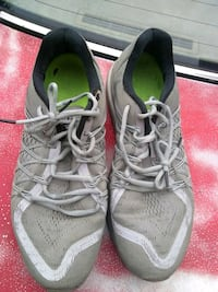 pair of gray Nike running shoes Lawrenceville, 30046