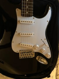 White and black electric guitar Richmond, V7A 2E5