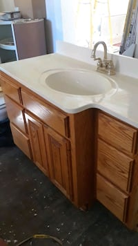Bathroom vanity with corian countertop and faucet sink cabinet