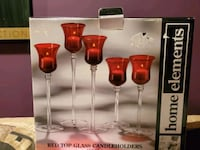 Set of red candle holders. New in box Burtonsville