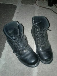 pair of black leather combat boots Winnipeg, R3C 1G7