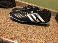 pair of black-and-white Adidas cleats Houston, 77048