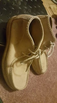pair of brown leather shoes