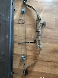 Left handed compound bow with case