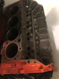 gray and red car engine part