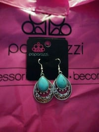 pair of teal-and-silver earrings Houston, 77060