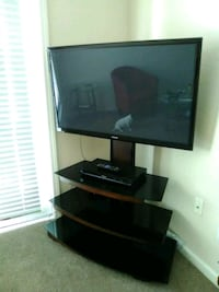 black flat screen TV with black TV stand Orlando, 32839
