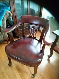 Leather and wood brass trim chair on wheels