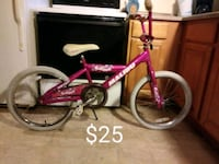 toddler's pink and white bicycle Englewood, 80113