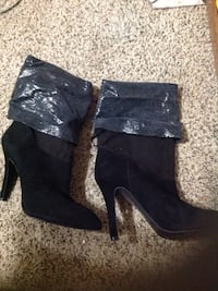 pair of women's black suede fold-down booties