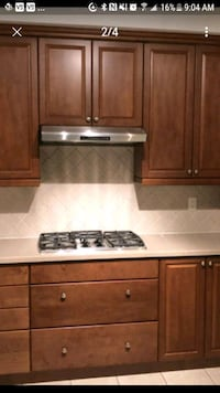 Built in cooktop oven microwave and hood range.
