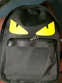 black and yellow Nike backpack