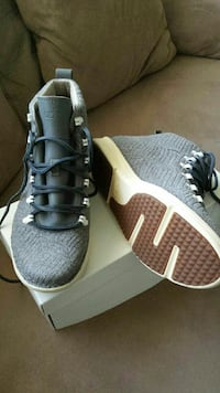 gray-and-brown high-top shoes with box