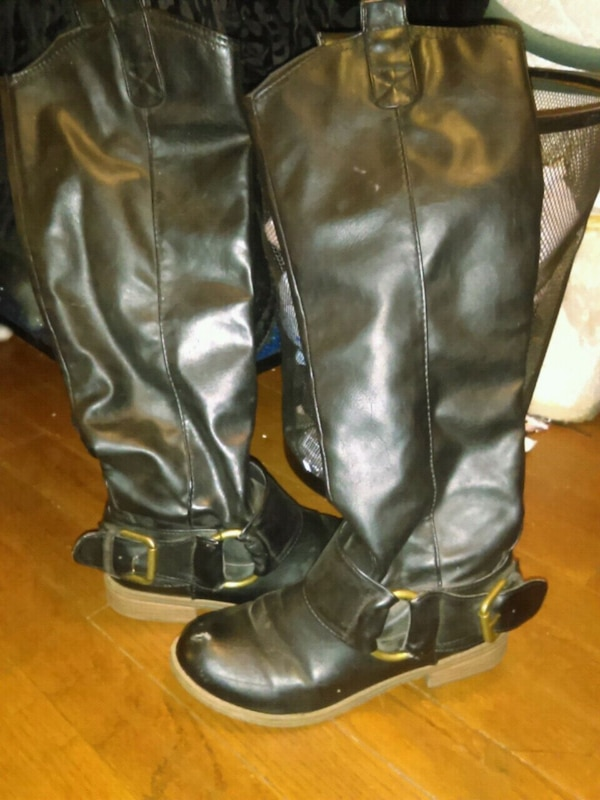 Black high rise leather boots