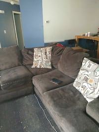 brown suede sectional sofa with throw pillows