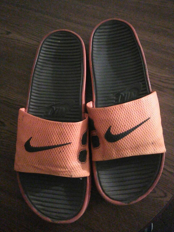size 40 54352 415a1 pair of orange and black nike slide on slippers