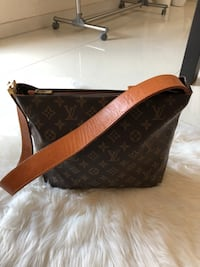 Braune louis vuitton ledertasche