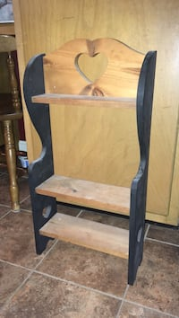 brown and black wooden wall-mount shelf