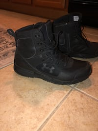 pair of black Nike Air Force 1 high shoes Tampa, 33609